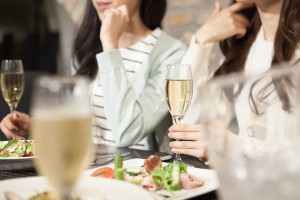 Women have a meal while drinking champagne