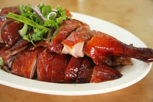 Roast duck chinese cuisine sliced portions on plate